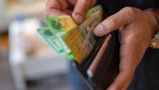 Úc: Việc thanh toán lương bằng tiền mặt sẽ không được khấu trừ thuế